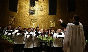The choir singing in Candlelight Carols