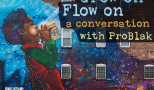 Close-up of a colorful mural of a Black boy with cosmic designs in his curly hair blowing air into a golden Zelda Nintendo cartridge. There are vibrant blue and purple clouds behind the boy. This mural is on the size of a building, located at 324 Blue Hill Avenue in Boston, Massachusetts. On the image here, the text 'Grow on, Flow on; a conversation with ProBlak' is laid over the mural with a grey screen separating the text from the image so that it is easier to read.