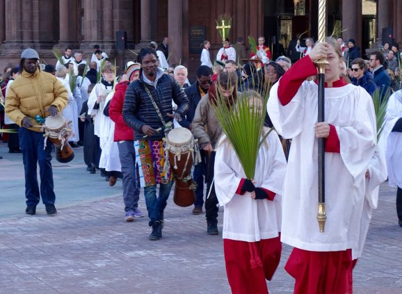 Acolytes and drummers lead the Palm Sunday procession.