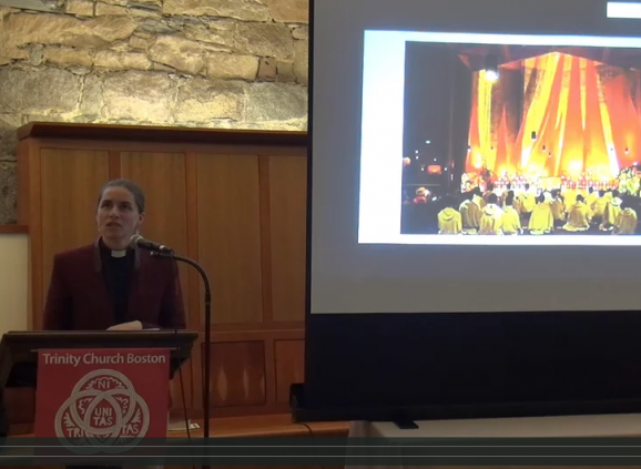 The Rev. Rita Powell speaks at a podium.