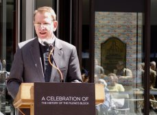 The Rev. Bill Rich recounted the Trinity's history in front of the new marker display.