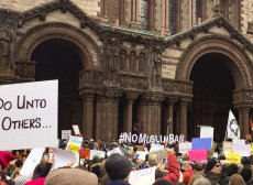 """""""Do Unto Others"""" says a sign at a protest against anti-Muslim discrimination outside Trinity."""