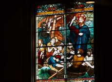 Trinity stained glass depicting Jesus