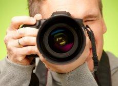 Male photographer taking photo