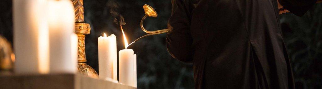 Altar Guild member lights candles at 6 p.m. service.
