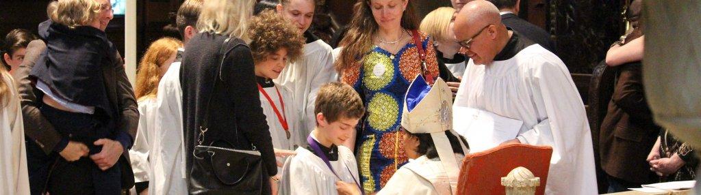 A teen being confirmed by Bishop Gayle Harris