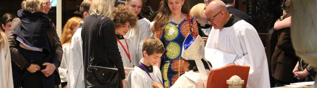 A teen being confirmed by Bishop Gayle Harris