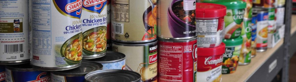 cans on food pantry shelf