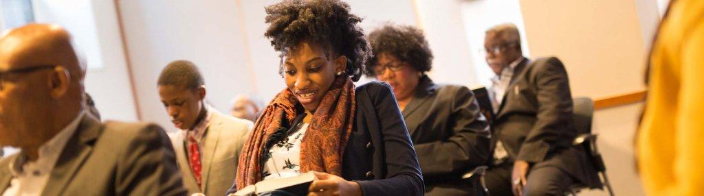 Woman reading at Nigerian Fellowship