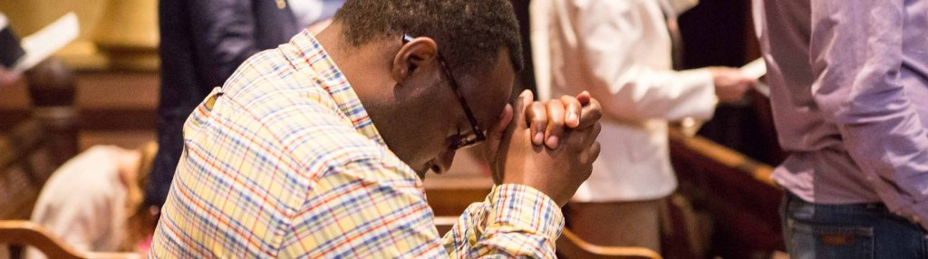 Parishioner kneeling in prayer