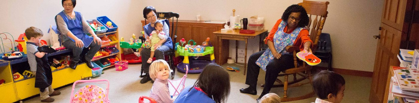 Church Nursery caretakers with children